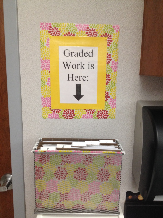 """out box"" for passing back graded work to students."