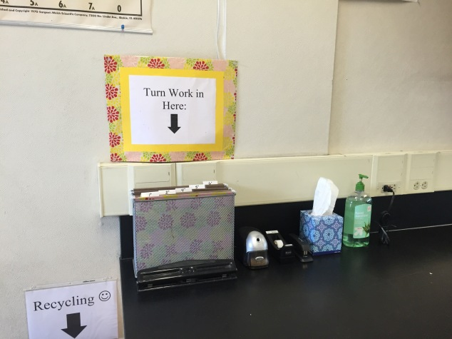 This is one of three student stations around the room. At this station students can sharpen their pencils, turn in their finished work, staple their work, three-hole-punch their work, use tape, blow their nose, and sanitize their hands! Each of my stations have all of the same supplies. See one of my other stations below.