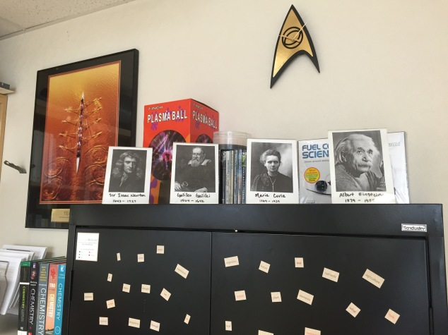 Again, I enjoy creating unique and fun decor in my classroom that both showcase my interests and Science. I like having the framed photos of famous Scientists as a reminder of our past and who have lead us to our current place of knowledge. I also have my awesome plasma ball that I bring out for fun demos during the year, my Star Trek clock (again, my personality), and a picture of rowing (my collegiate sport as well as a representation of team work-- very important in a Science classroom!). On the black cabinet I have magnet words for my students to crete poetry. So far, I have found a Haiku about food-- it was during 4th period before lunch, so not much of a surprise there.